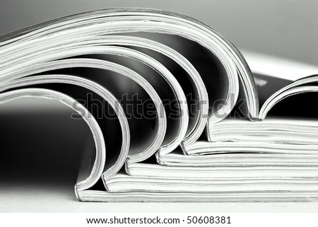 Heap of magazines in black and white - stock photo