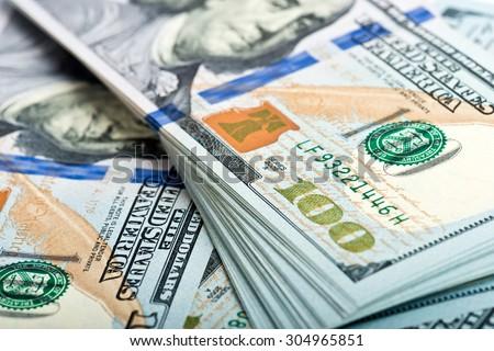 Heap of many American dollar bills - stock photo