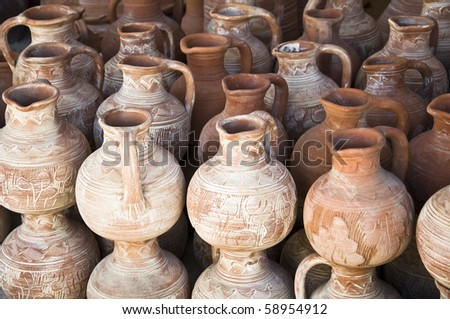 heap of many terracotta clay pots - stock photo