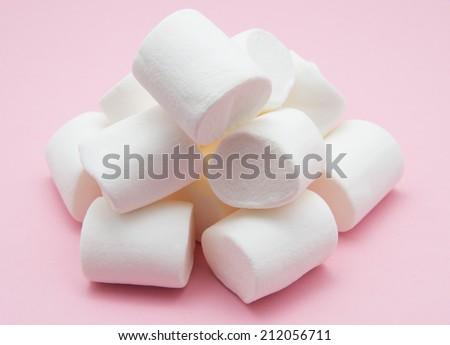 heap of marshmallow on pink - stock photo