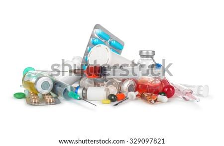 heap of medical syringes, bottles, pills, ampules isolated on white - stock photo