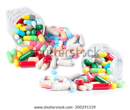 Heap of medicine pills isolate on white.