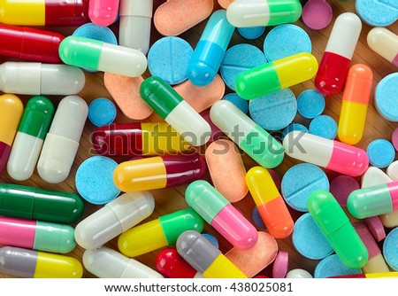 Heap of medicine pills isolated on background.
