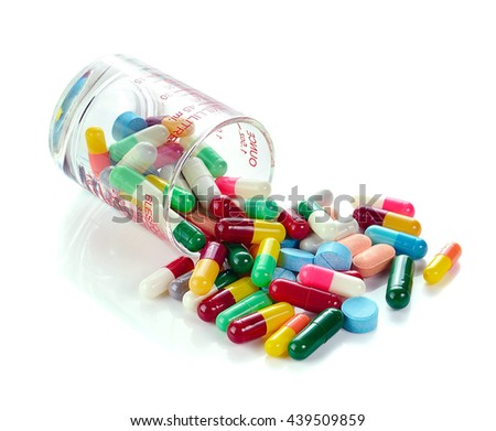 Heap of medicine pills isolated on background. - stock photo