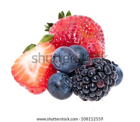 Heap of mixed berries isolated on white background - stock photo
