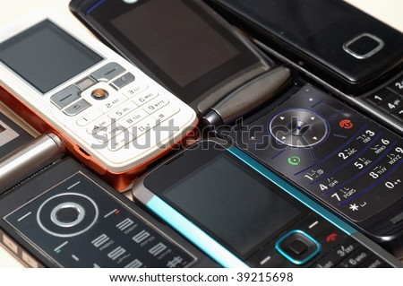 Heap of mobile phones, all kinds of brands. - stock photo