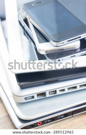 heap  of modern electronical devices close up - technology concept - stock photo