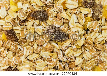 Heap of muesli. Delicious granola cereal mix, with dried fruit and seeds. - stock photo