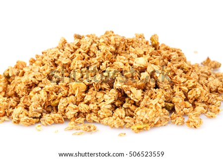 Heap of muesli on white background.