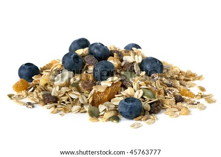 Heap of muesli with fresh blueberries, isolated on white.  Delicious granola cereal mix, with dried fruit and seeds. - stock photo