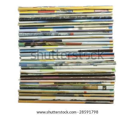 Heap of multi-coloured old magazines on a white background it is isolated - stock photo