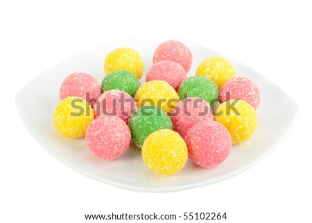 Heap of multicolored sweets on white plate. Isolated on white background. Close-up. Studio photography. - stock photo