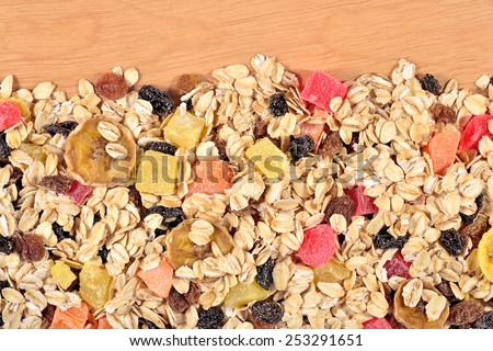 Heap of musli on a wooden background - stock photo