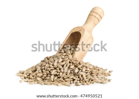 Heap of natural shelled sunflower seeds in wooden scoop over white background