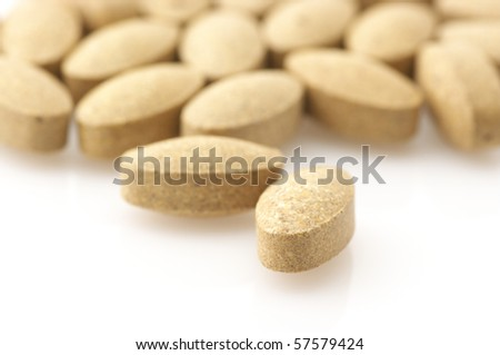 Heap of nutritional supplement pills on white background. - stock photo