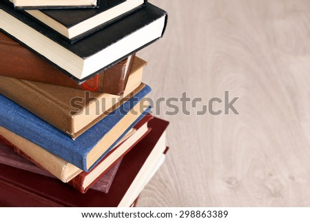 Heap of old books on wooden background - stock photo