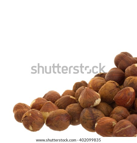 Heap of old hazelnuts, ready for consumption, selective focus - stock photo