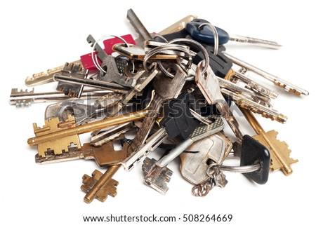 Heap of old keys isolated on white