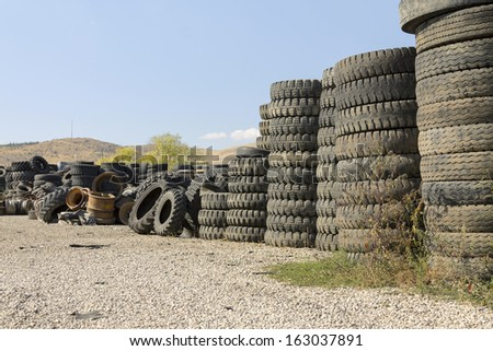 Heap of old Tires in recycling plant - stock photo