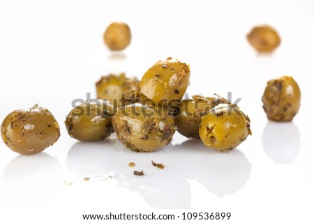 Heap of olives with seasoning on white background - stock photo