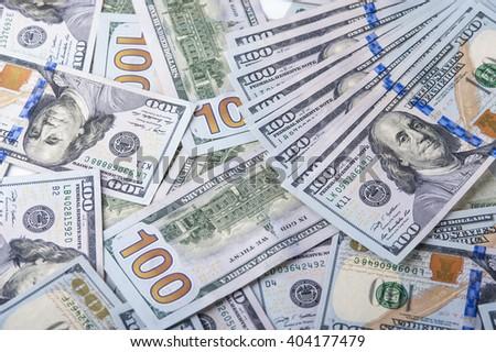 Heap of one hundred dollar bills, one hundred dollar bills background. - stock photo