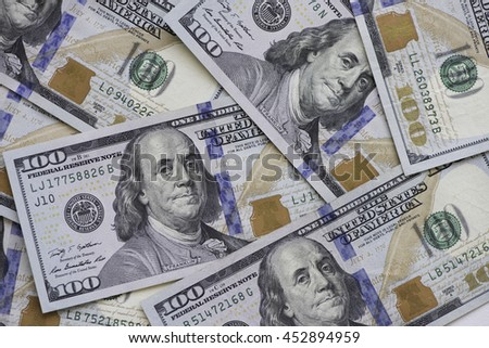 Heap of one hundred US dollar banknotes. - stock photo