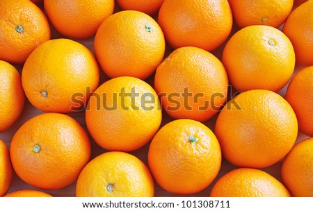 Heap of oranges, top view - stock photo