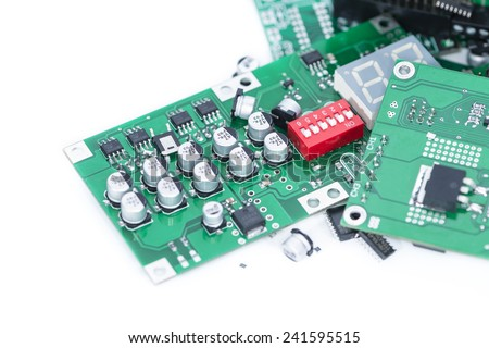 Heap of PCBs and electronic components isolated on white background - stock photo