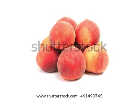 Heap of peaches isolated on white background
