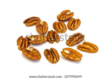 Heap of  Pecan nuts pile on white background , macro image . - stock photo