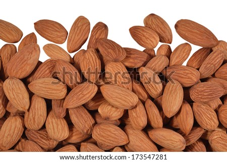 Heap of peeled almonds on a white background - stock photo