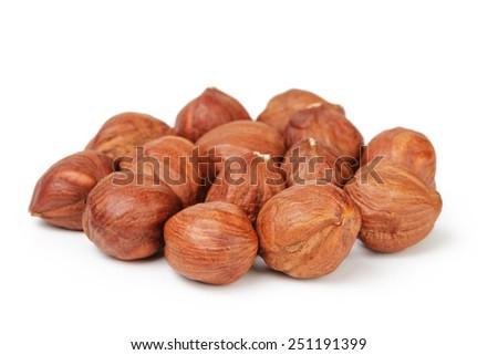 Heap of peeled hazelnuts isolated on white - stock photo