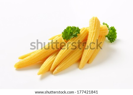 heap of pickled baby corns with parsley - stock photo