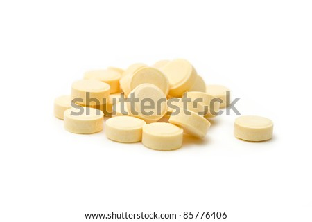 Heap of pills isolated on white background - stock photo