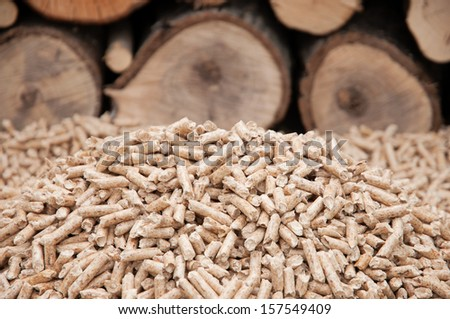 Heap of pine pellets- selective focus on the heap- stock photo - stock photo