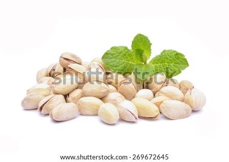 Heap of pistachio isolated on white background - stock photo