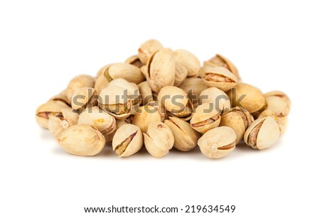 Heap of pistachio nuts isolated on white background - stock photo