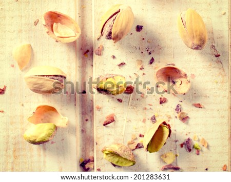 Heap of pistachio on the wooden table from above - stock photo