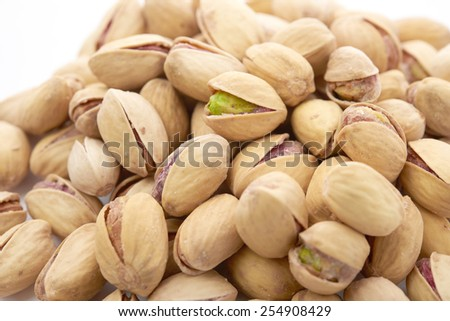 Heap of pistachios nuts - stock photo
