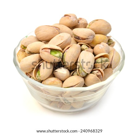 Heap of pistachios nuts in glass bowl isolated om the white  - stock photo