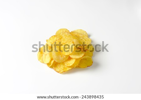 Heap of potato chips on white background - stock photo