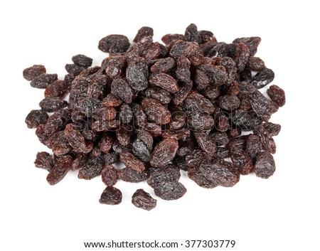 Heap of raisins close up over white background - stock photo