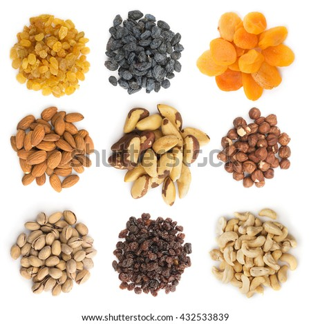 Heap of raisins, different nuts and apricot isolated on white. Collection, set.