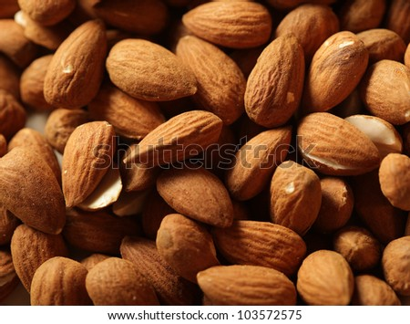 Heap of raw almonds nuts background - stock photo