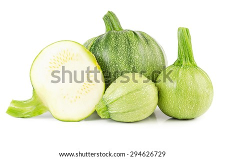 Heap of raw courgettes isolated on white background - stock photo