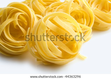 heap of raw dry nest pasta  over white background - stock photo
