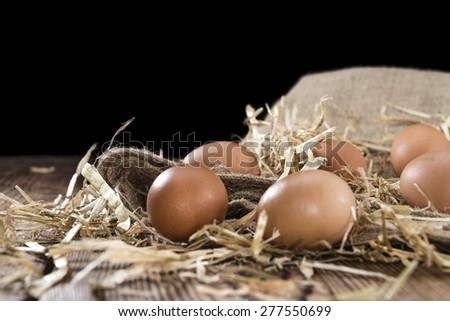 Heap of raw Eggs on rustic wooden background - stock photo