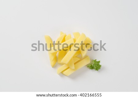 heap of raw french fries on white background - stock photo