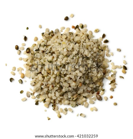 Heap of raw peeled hemp seeds on white background