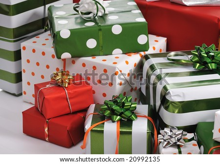 heap of red and green Christmas gifts isolated on white background - stock photo